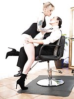 Sinn Sage strides confidently into a small barbershop, wearing a striking suit and looking for stellar service. She grabs a magazine while waiting, then looks up to the sound of heels clicking across the floor. The sexy barber, Lena Kelly, saunters close