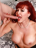 Redheaded mature slut Sexy Vanessa gets naked and suck a dick