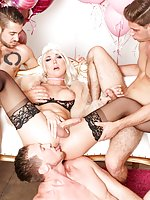 Surrounded by pink birthday balloons, blonde TS stunner Aubrey Kate shows off her plump tits and bodacious butt. She crawls to service three hard cocks! Michael DelRay, Pierce Paris and Dante Colle line their thick pricks up for Aubrey's slobbering, gaggi