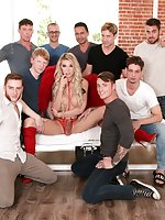 In red stockings and matching angel wings, blonde TS superstar Aubrey Kate spreads her sculpted legs, probes her butthole and lewdly sucks her fingers clean. The tattooed trans goddess finds herself surrounded by nine horny dudes (Chad Diamond, Gabriel Da