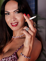 Busty Carla Abiazza being a total tease as she enjoys a smoke for you smoking fetish lovers!