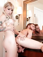 Slender TS doll Lena Kelly primps in her mirror, applying lip-gloss and squeezing her natural tits. The tattooed blonde strokes her stiffening dick; eager stud Sebastian Keys immediately takes over with his mouth, worshiping Lena's throbbing she-cock and