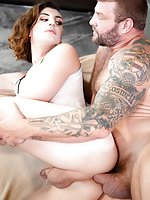 Dressed in a sheer one-piece and red pumps, tall, athletic TS model Allysa Etain strokes her big she-cock and spreads her buttocks to expose her crinkly anus to the camera. Beefy, bearded daddy-dom Colby Jansen enters, and Allysa eagerly sucks on his big