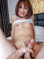 Natural-body Ladyboy Kwan is wearing a colorful blouse, purple panties, and stockings. She stands by the curtains and shows off her sexy body for the POV. She bends over on top of a chair and pulls her panties aside, exposing her ass-pussy. Kwan sits on t